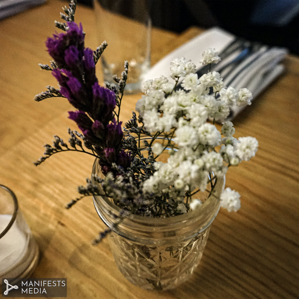 Fresh table flowers with sprigs of baby's breath at the Pinewood in Decatur, Georgia.